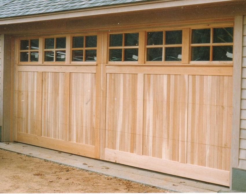 Oversized garage door with ganged windows on windowsills for Oversized garage doors